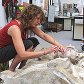 Conservator working on a stone monument in the sculpture conservation studio