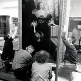 Installation of a painting of The Countess of Derby in the British Galleries