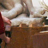 Tapping oak wedges around the base of the sculpture