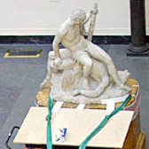 2-ton capacity slings (green) secured around base of sculpture