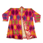 Man's robe with large spots on a bright pink background, from the Rau collection