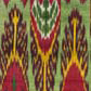 Ikat length with pink, yellow and blue design on green background. Museum no. 79