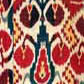 Ikat hanging with red circle design, from the Rau collection
