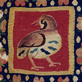 Tapestry-woven panel showing a quail, 4th or 5th century. Museum no. 284-1891