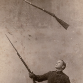 Juggling rifles, late 19th century