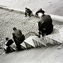 Ilse Bing, 'Three men on steps by the Seine'