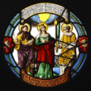 Stained glass with St Stephen on the right holding a palm branch