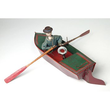 Clockwork toy boat and sailor