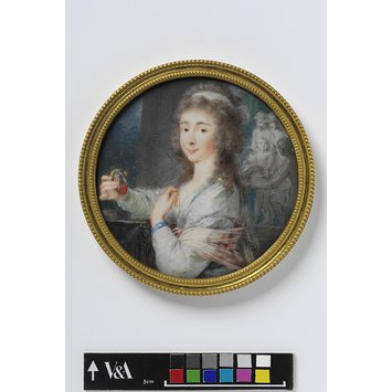 Portrait miniature - An Unknown woman holding a miniature