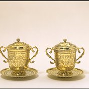 Two-handled lidded cup with stand