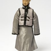 Doll representing a boy servant from a set of nine