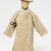 Doll representing a priest from a set of nine