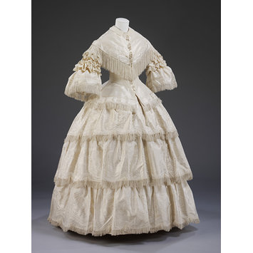 1857 white basque wedding dress with tiered skirt, from the VAM