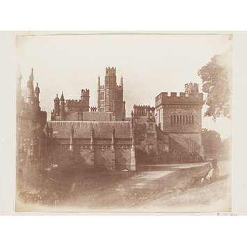 Photograph - Margam Castle with a man recling on a grass bank