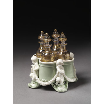 Cruet stand with four bottles