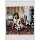 Untitled [Young woman seated on the floor at home in front of her television set] (Photograph)