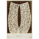 Fichu composed of two strips of point lace stitched together.  Venetian. (Photograph)