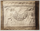 Bas-relief of portion of frieze of dancing figures with torches bearing festoon of fruit in terra cotta (photograph)